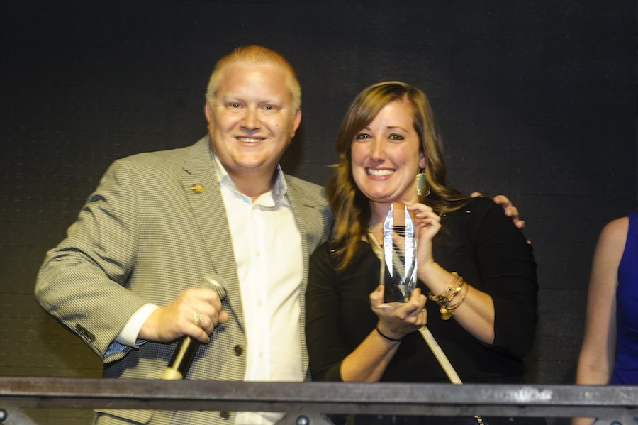Shyla Magee (right) accepting the Large NOTY on behalf of the Greater Las Vegas Association of REALTORS® YPN.