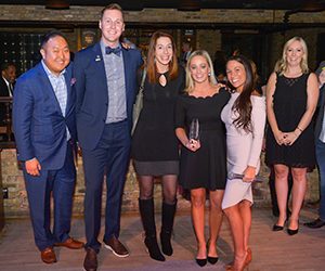 small group of ypn members holding an award