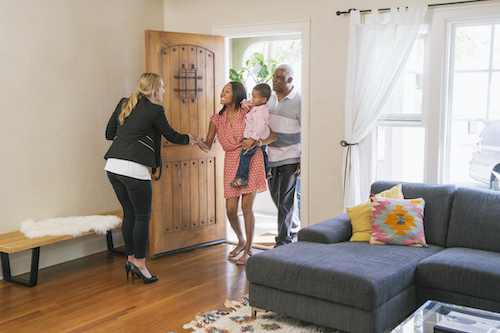 eal estate agent showing house to clients